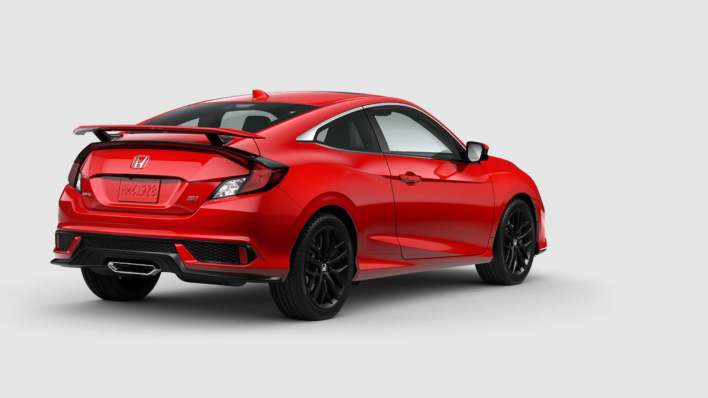 Rear view of 2020 Honda Civic Si Coupe in Rallye Red.
