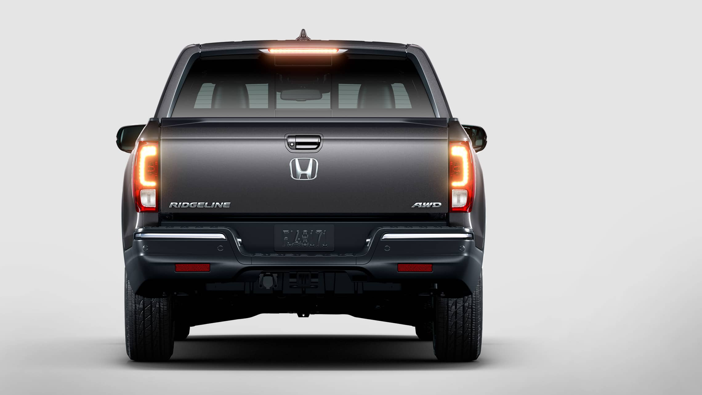 Rear view of 2020 Honda Ridgeline RTL-E in Modern Steel Metallic displaying LED taillights.