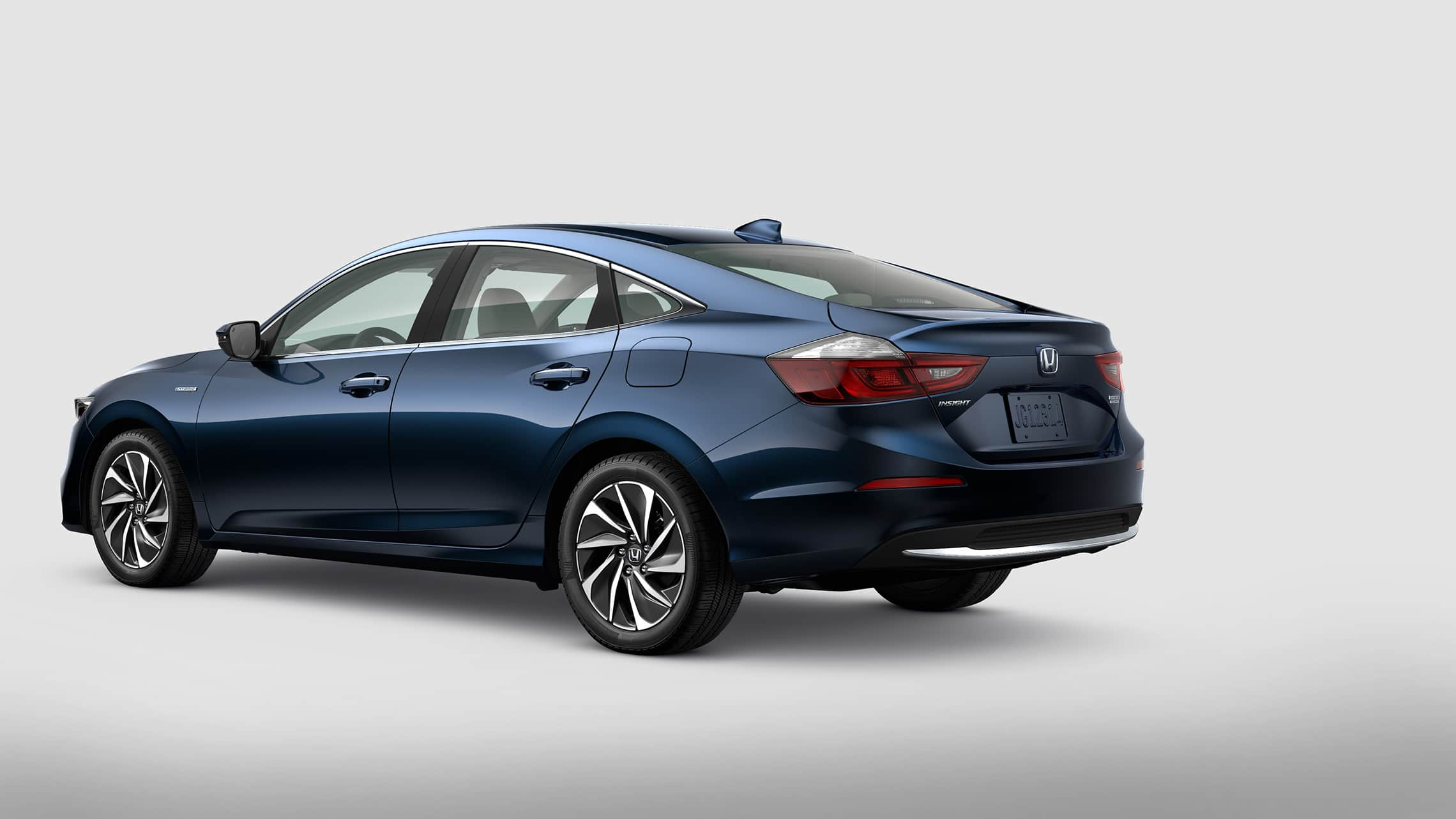 Rear driver-side view of 2021 Honda Insight Touring in Cosmic Blue Metallic.